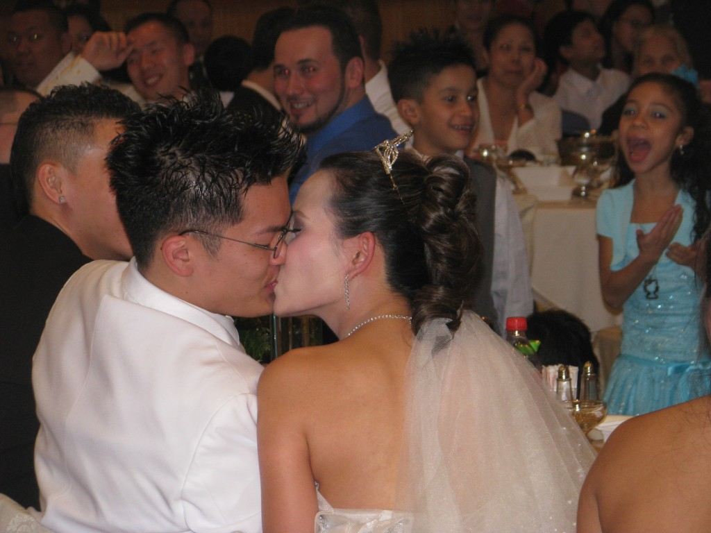 Bride and Groom Kissing with Fun Rhode Island Multicultural Wedding DJ