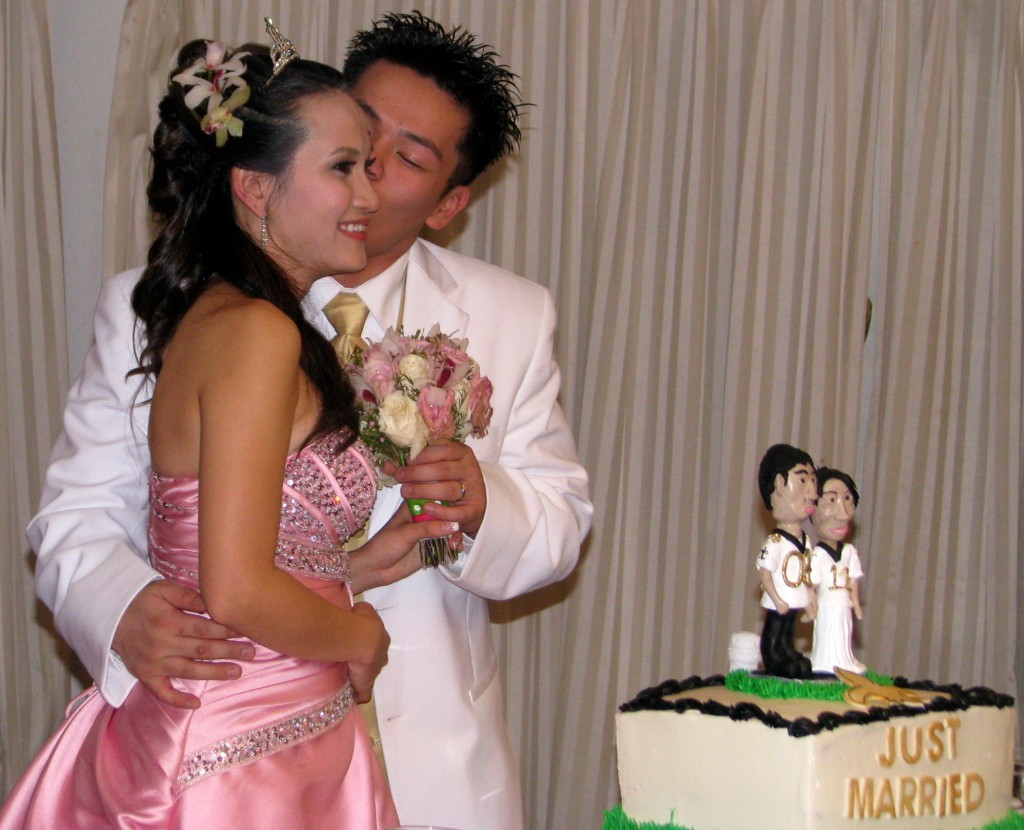 Bride and Groom Cutting Cake with Fun Rhode Island Multicultural Wedding DJ