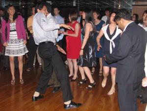 Fun Men Raising Hands on Dance Floor at Asian Wedding