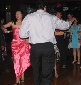 Fun Men Raising Hands on Dance Floor at Chinese Wedding