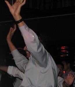 Fun Men Raising Hands on Dance Floor