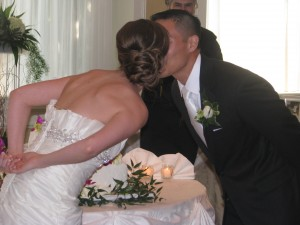 Bride and Groom Kissing over Cake with Fun Rhode Island Multicultural Wedding DJ