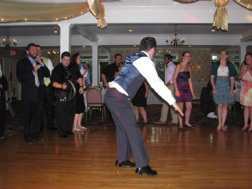 Happy Groomsman Dancing with Amazing Wedding DJ