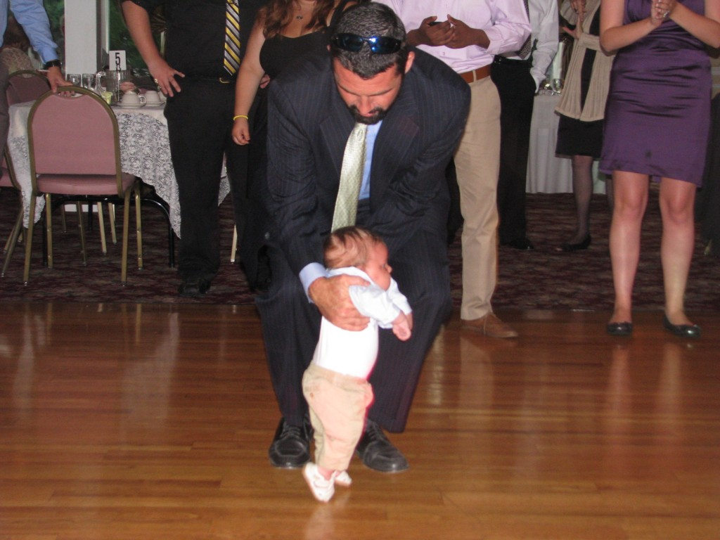 Happy Father and Baby Dancing with Amazing Wedding DJ