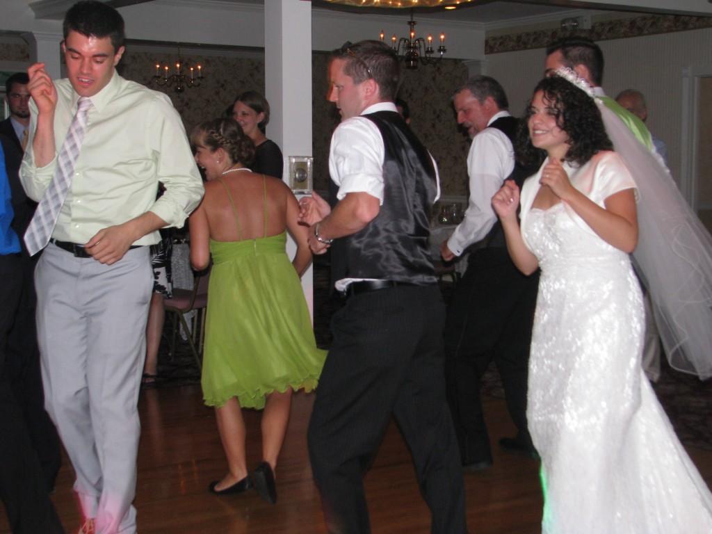 Bride Having Fun Dancing at Fun Wedding