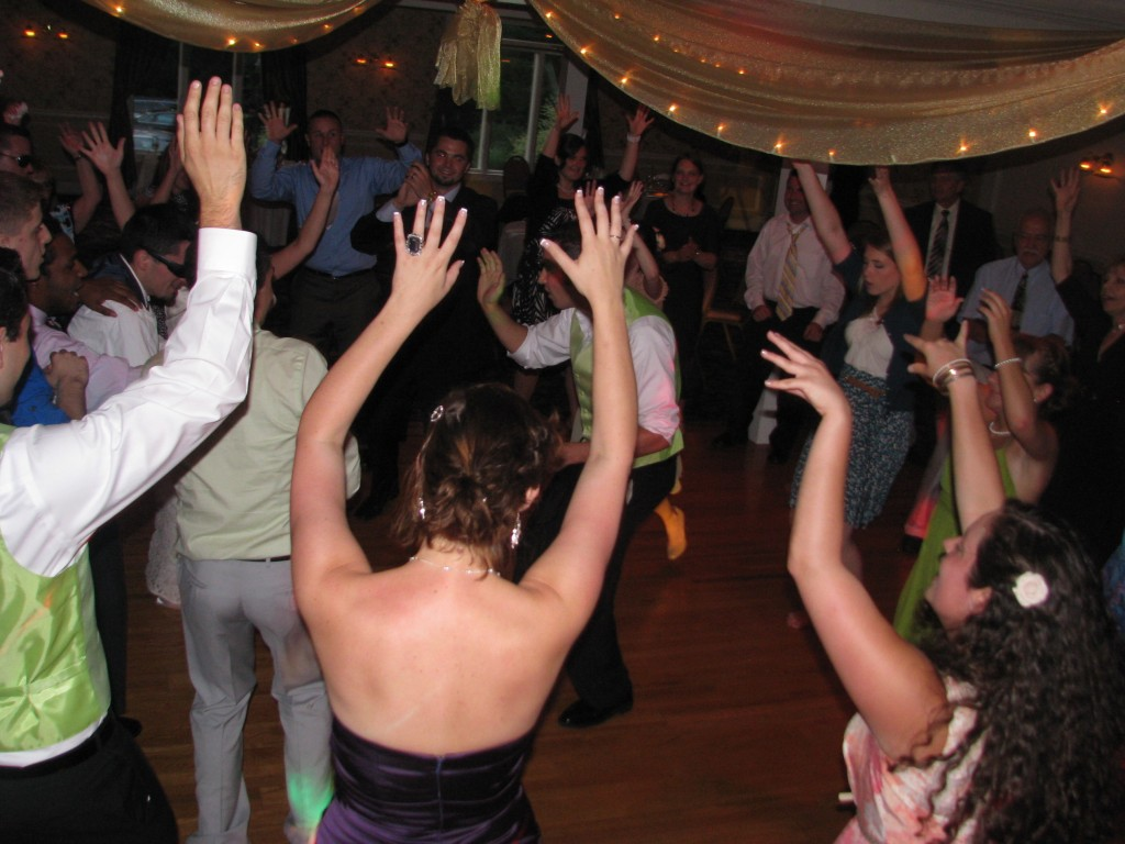 Groom Having Fun with Friends and Family Dancing with Fun Wedding DJ