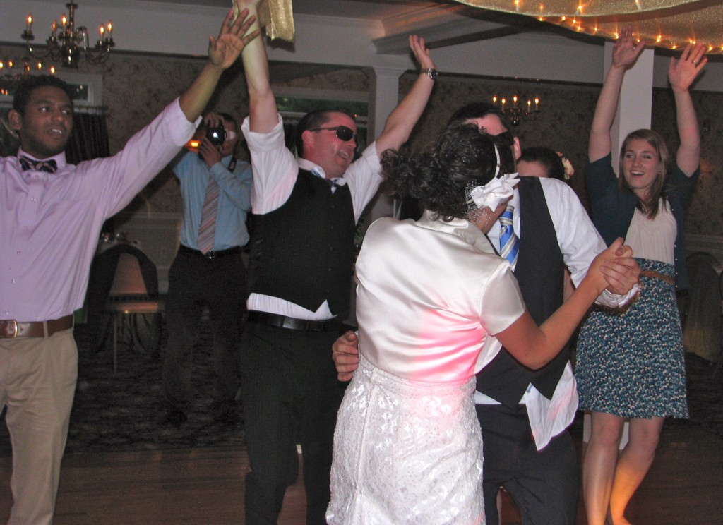 Bride Having Fun with Friends and Family Dancing with Fun Wedding DJ