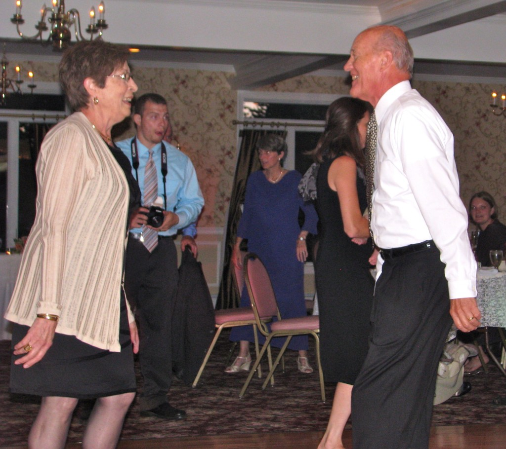 Couple Having Fun with Friends and Family Dancing with Fun Wedding DJ