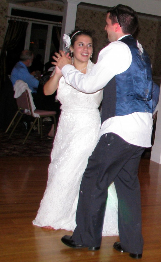 Bride with Friends and Family Dancing with Fun Wedding DJ