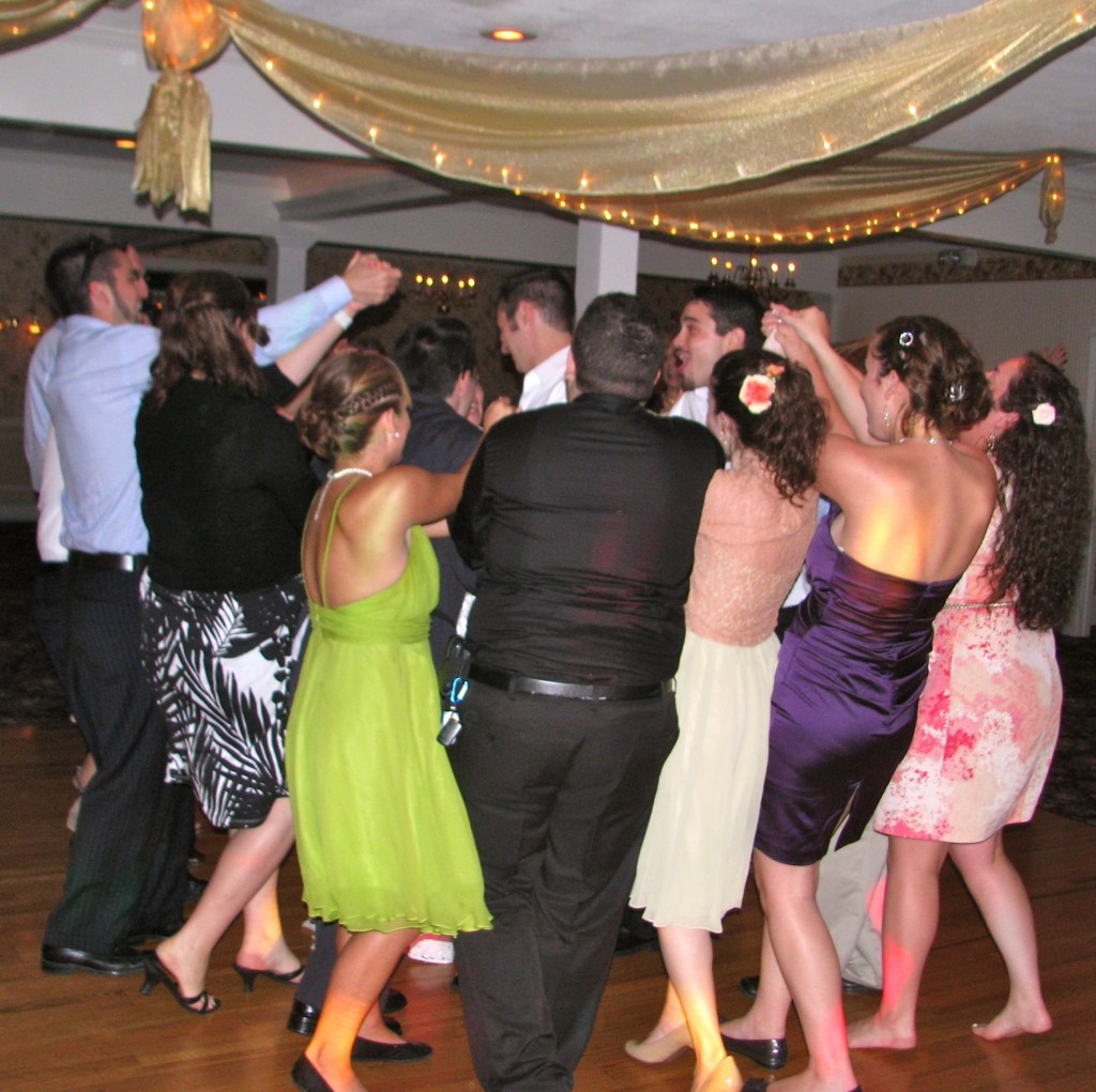 Bride and Groom Celebrate Wedding Friends and Family Dancing with Fun Rhode Island Wedding DJ